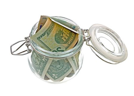 6601674 - different money in the glass jar isolated on white background